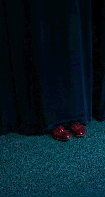 The shoes behind the curtain