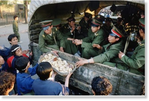 Tianenment protestors give food to police