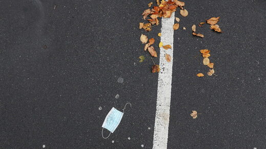 discarded mask litter